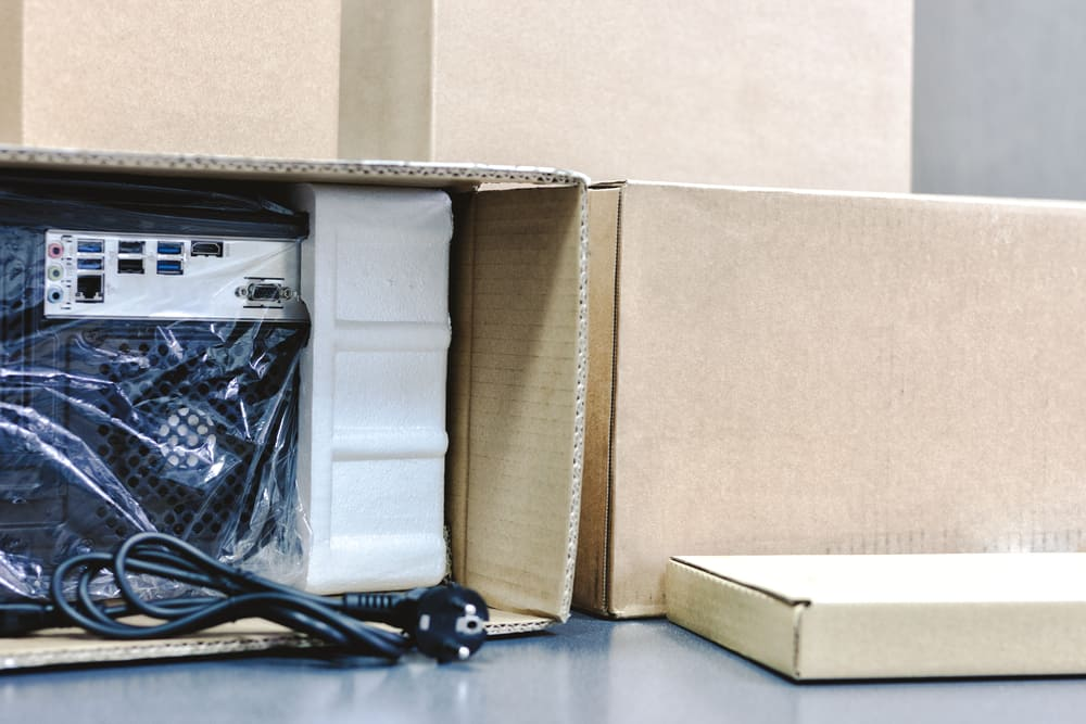 depositphotos_247816576-stock-photo-unpacking-black-personal-computer-back